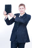 Cheerful man showing Bible stock photo