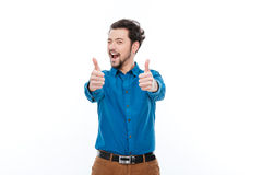 Cheerful man showing thumbs up Stock Photos