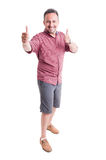 Cheerful man showing thumbs up Royalty Free Stock Photos
