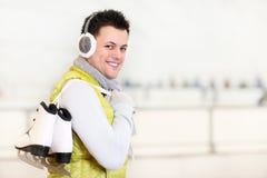 Cheerful man on a skating rink Stock Photos