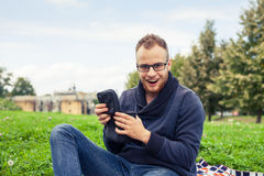 Cheerful man surprised and happy of what's inside his gift box. Royalty Free Stock Photos