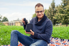 Cheerful man surprised and happy of what's inside his gift box. Stock Photography
