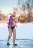 Cheerful man after swimming  cold water Royalty Free Stock Images