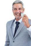 Cheerful man taking away adhesive tape from mouth Stock Image