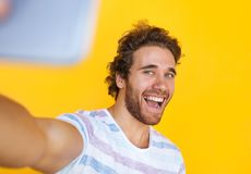 Cheerful man taking selfie Stock Image