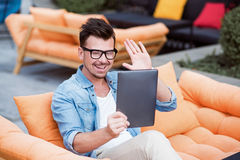 Cheerful man talking through the Internet Royalty Free Stock Photography