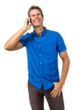 Cheerful man talking on mobile phone Stock Photo