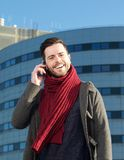 Cheerful man talking on mobile phone in the city Royalty Free Stock Images