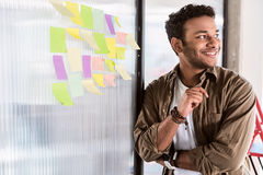 Cheerful man thinking about business project Royalty Free Stock Image