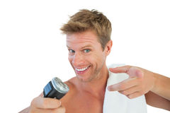 Cheerful man about to shave his stubble Stock Images