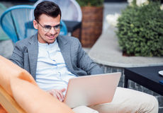Cheerful man using laptop Royalty Free Stock Photo