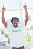 Cheerful man with volunteer tshirt raising his arms Royalty Free Stock Photography