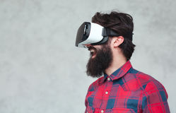 Cheerful man in VR helmet stock photos