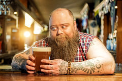 Cheerful man wanting to taste ale Stock Images