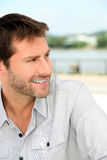 Cheerful man by the water Royalty Free Stock Photos