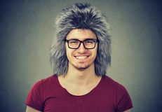 Cheerful man wearing furry hat stock images