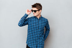 Cheerful man wearing sunglasses stock images