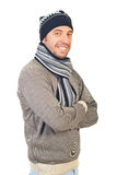 Cheerful man in winter clothes. Cheerful smiling man in winter knitted clothes standing with arms folded isolated on white background Stock Photos