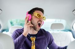 Free Cheerful Man With Party Accessories Sitting In Car, Having Fun. Royalty Free Stock Image - 164928566
