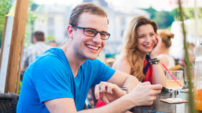 Cheerful man and woman couple in cafe. Stock Image