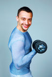 Cheerful man working out with dumbbells Royalty Free Stock Photography