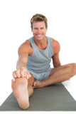 Cheerful man working out on the floor Royalty Free Stock Image