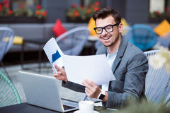 Cheerful man working with papers. Stock Images