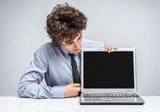 Cheerful manager looking at screen laptop. Stock Photo