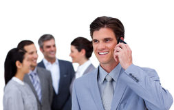 Cheerful manager on phone standing Royalty Free Stock Images