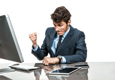 Cheerful manager is satisfied with his profit, income, earnings, gain, benefit, margin Stock Photos