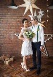 Cheerful married couple dancing near the brick wall Royalty Free Stock Image