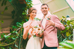 Cheerful married couple in hothouse Royalty Free Stock Photo