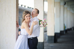 Cheerful married couple at train station Royalty Free Stock Photo