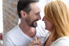 Cheerful marrieds relaxing at home Stock Photo
