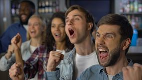 Cheerful match spectators celebrating goal, supporting team, entertainment. Stock footage stock video footage