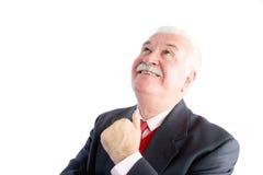 Cheerful mature businessman looking upwards Stock Photo