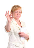 Cheerful mature businesswoman giving the ok sign Royalty Free Stock Photo