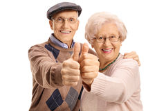 Cheerful mature couple making a thumbs up gesture Stock Image