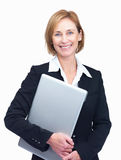 Cheerful mature female entrepreneur holding laptop Stock Photography