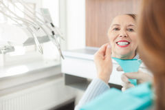 Cheerful mature lady is checking work of orthodontist Stock Images