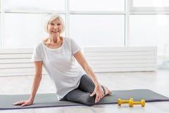 Cheerful mature lady likes morning exercises Royalty Free Stock Photos