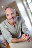 Cheerful mature man relaxing at home Royalty Free Stock Image