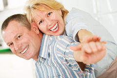 Cheerful mature man and woman smiling together Stock Image