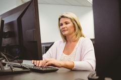 Cheerful mature student using laptop Royalty Free Stock Images