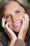 Cheerful mature woman Stock Image