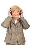 Cheerful mature woman with headphones Royalty Free Stock Photos