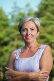 Cheerful mature woman looking at camera Royalty Free Stock Images