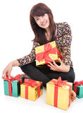 Cheerful mature woman with lots of gifts Royalty Free Stock Images
