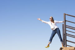 Cheerful mature woman outdoor jumping Stock Photo