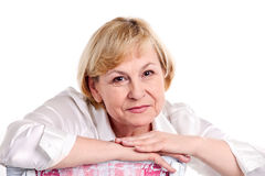 Cheerful mature woman over white background Stock Photography